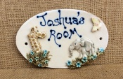 Giraffe and Elephant room name plaque